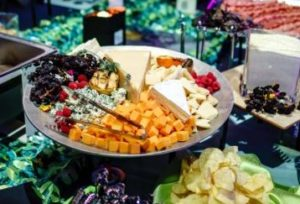 Appetizers and a cheese platter laid out for a corporate party