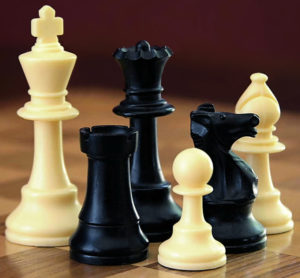 Black and white chess pieces on a chess board