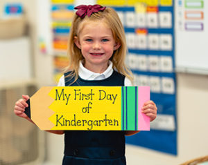 A young private school student on her first day of Kindergarten at Saint Gregory's School