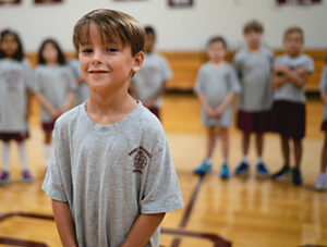 A young private school student smiling during gym class