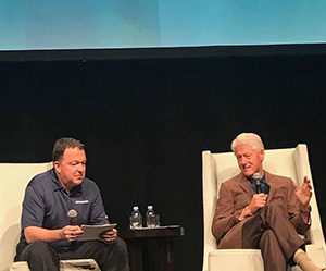 Former President Bill Clinton at the keynote entrance to Akullian Creative's user conference in Miami, FL