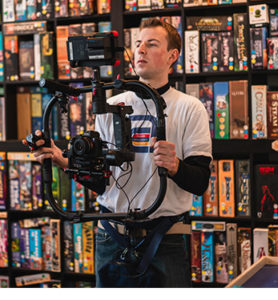 A man holding a Sony camera on a gimbal to shoot b-roll footage