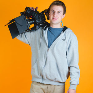 Our video producer, Andrew, holding a Sony FS5 camera with a matte box