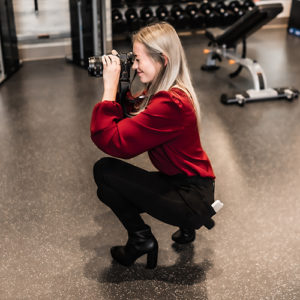 Our digital marketing strategist Kelly holding a Sony a7rii camera to get the perfect shot