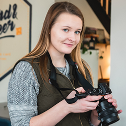 Our graphic designer Esther holding a Sony a7rii camera at a client shoot