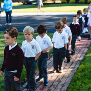 Kindergarteners of Saint Gregory's private catholic school walking on their first day of school