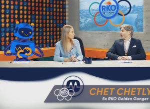 Two reporters in front of an animated green screen for an olympic-style sales video