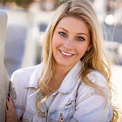 Our social media marketer Sydney smiling in Santa Barbara, CA
