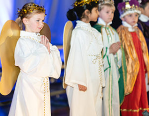 Young children dressed up as angels and kings for a Christmas Pageant