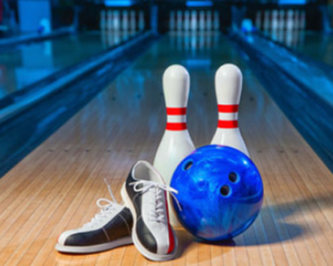 A set of bowling shoes, a blue bowling ball, and two bowling pins