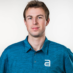 Our filmmaker, Andrew, wearing an Akullian Creative blue polo