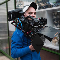 A video producer holding a Sony FS5 camera in Manhattan
