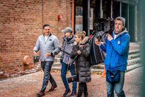 A group of video producers speaking to a client in New York City