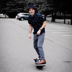 Akullian Creative's CEO riding a Onewheel