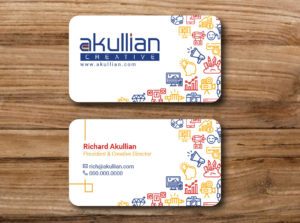 High-quality and custom-designed business cards for a Creative Agency on a wooden background