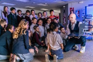 A CEO giving an entrepreneurship presentation to students of a private school in Albany, NY