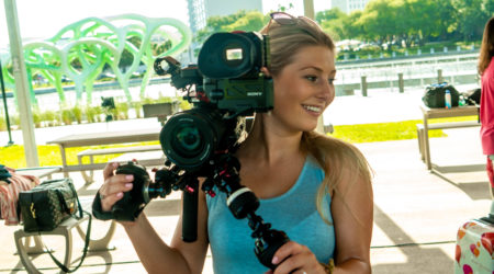 Blonde woman holding a Sony FS5 camera in Tampa, FL