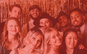 The entire Akullian Creative team at a 1920's themed gala with a red overlay