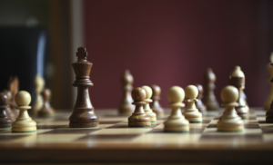Brown and white chess pieces on a board