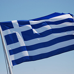 The Greek Flag blowing in the sky