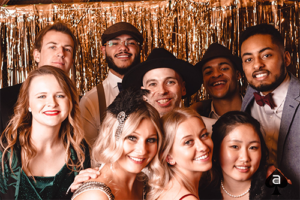 A group of creatives dressed up for a Roaring 20's party
