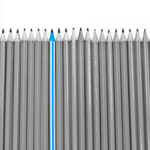 Black and white pencils in a line, one blue pencil stands out among them