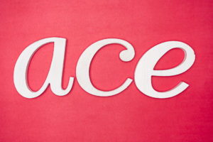 ACE letters on red background